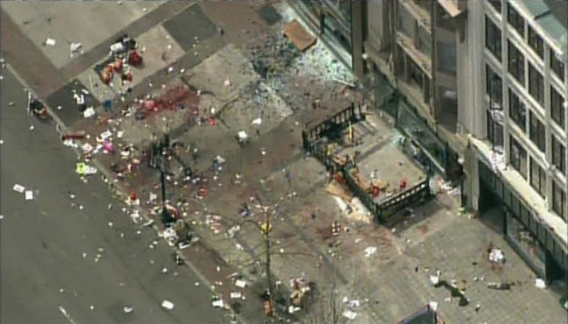 . Still image taken from video courtesy of NBC shows the scene of an explosion at the Boston Marathon, in Boston, Massachusetts, April 15, 2013. Two explosions struck the marathon as runners crossed the finish line on Monday, witnesses said, injuring an unknown number of people on what is ordinarily a festive day in the city. REUTERS/NBC/Handout