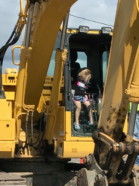 Mekenzie in Papa Jim's backhoe