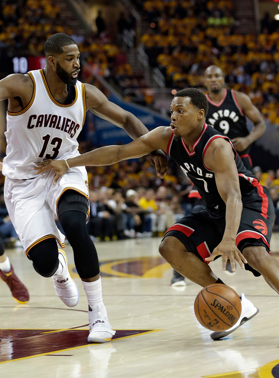 . Toronto Raptors\' Kyle Lowry (7) drivers pat Cleveland Cavaliers\' Tristan Thompson (13) in the first half in Game 1 of a second-round NBA basketball playoff series, Monday, May 1, 2017, in Cleveland. The Cavaliers won 116-105. (AP Photo/Tony Dejak)