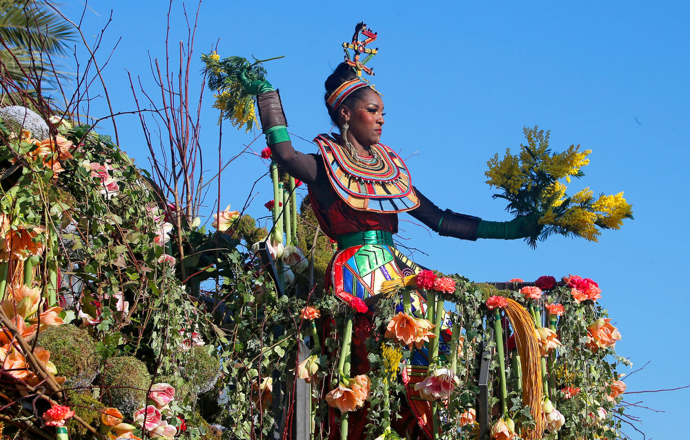 ". A reveler parades during the flower parade of the 129th edition of the Nice Carnival, Saturday, Feb. 16, 2013, in Nice, southern France. The carnival celebrates the theme ""King of the 5 continents\"". (AP Photo/ Lionel Cironneau)"