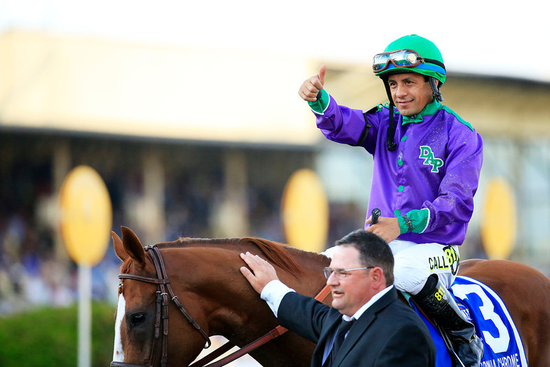 . Victor Espinoza celebrates atop California Chrome #3 with assistant trainer Alan Sherman after winning the 139th running of the Preakness Stakes at Pimlico Race Course on May 17, 2014 in Baltimore, Maryland.  (Photo by Patrick Smith/Getty Images)