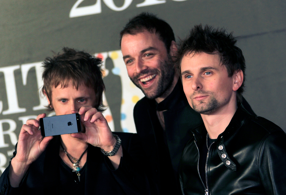 Description of . From left, Dominic Howard, Christopher Wolstenholme, and Matthew Bellamy of British band Muse seen arriving at the BRIT Awards 2013 at the o2 Arena in London on Wednesday, Feb. 20, 2013. (Photo by Joel Ryan/Invision/AP)