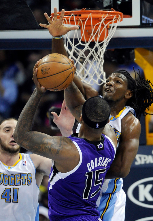 . DENVER, CO. - MARCH 22: Kenneth Faried (35) of the Denver Nuggets put a stop to a drive by DeMarcus Cousins (15) of the Sacramento Kings inthe first half. The Denver Nuggets hosted the Sacramento Kings Saturday night, March 23, 2013 at the Pepsi Center. (Photo By Karl Gehring/The Denver Post)