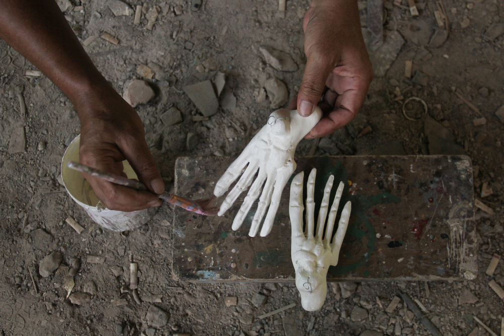 . A craftsman completes the creation of the human hand bones on April 23, 2014 in Depok, West Java, Indonesia. The mannequins are made from fiberglass and will be used in schools, hospitals and laboratories.  (Photo by Nurcholis Anhari Lubis/Getty Images)
