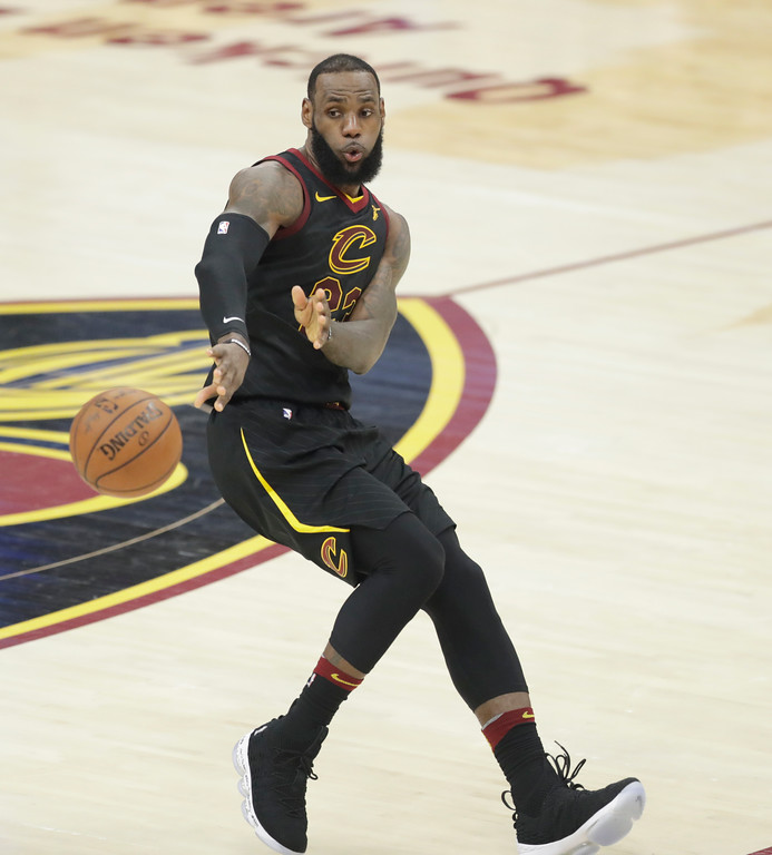 . Cleveland Cavaliers\' LeBron James (23) passes against the Boston Celtics in the second half of Game 3 of the NBA basketball Eastern Conference finals, Saturday, May 19, 2018, in Cleveland. (AP Photo/Tony Dejak)