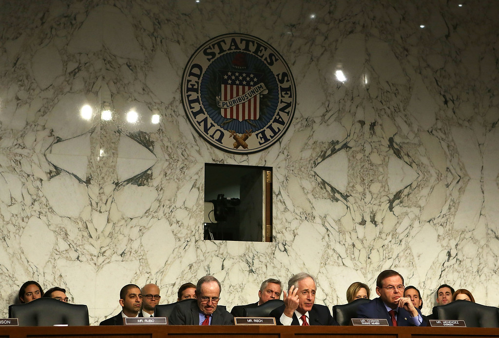 . WASHINGTON, DC - JANUARY 23:  Committee ranking member U.S. Senator Bob Corker (R-TN) (C) speaks as Senator James Risch (R-ID) (L) and committee chairman Senator Robert Menendez (D-NJ) (R) listen during a hearing before the Senate Foreign Relations Committee on Capitol Hill January 23, 2013 in Washington, DC. Lawmakers questioned Clinton about the security failures during the September 11 attacks against the U.S. mission in Benghazi, Libya, that led to the death of four Americans, including U.S. Ambassador Christopher Stevens. (Photo by Alex Wong/Getty Images)