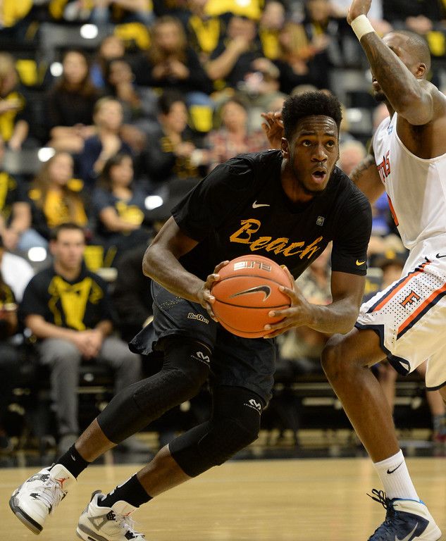 . Long Beach\'s David Samuels (11) drives the ball to the basket against Fullerton in a Big West mens basketball game at the Pyramid Saturday, February 01, 2014, Long Beach CA.   Long Beach won 75-56. CSU Long Beach versus CSU Fullerton Photo by Steve McCrank/Daily Breeze