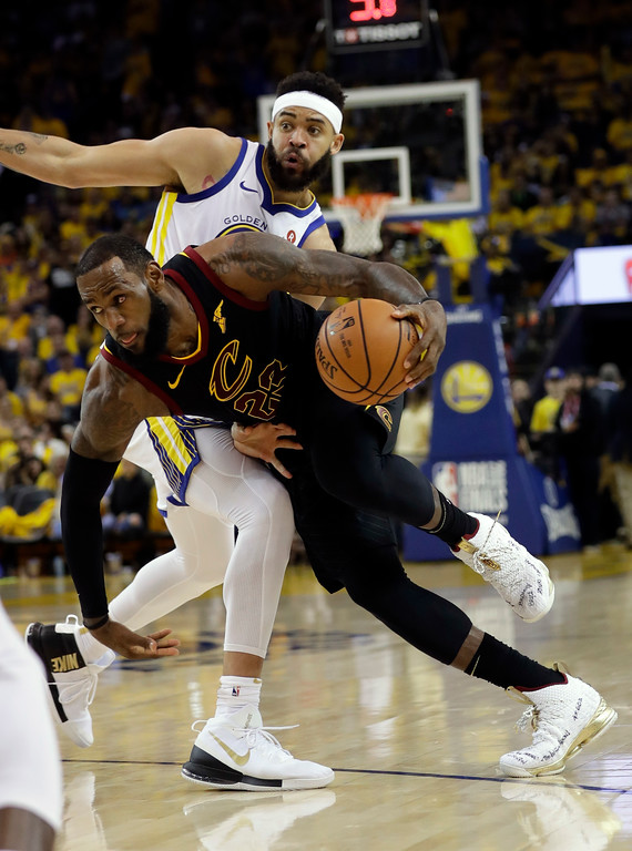 . Cleveland Cavaliers forward LeBron James (23) dribbles past Golden State Warriors center JaVale McGee during the second half of Game 1 of basketball\'s NBA Finals in Oakland, Calif., Thursday, May 31, 2018. (AP Photo/Marcio Jose Sanchez)