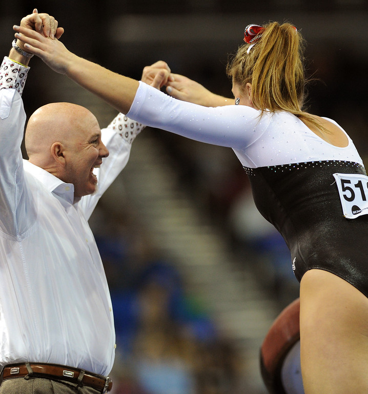 . Georgia assistant coach Jay Hogue congratulates Brittany Rogers after her vault at the NCAA Women\'s Gymnastics Championship Team Finals at Pauley Pavilion, Saturday, April 20, 2013. (Michael Owen Baker/Staff Photographer)