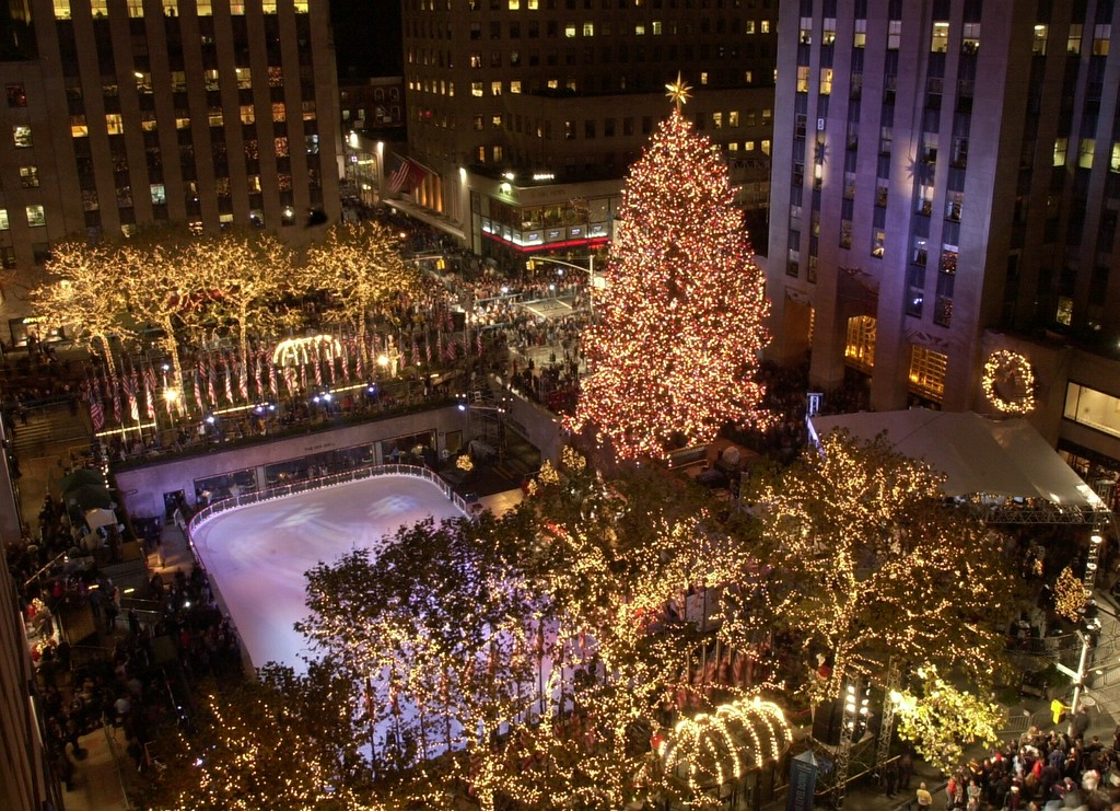 . The Christmas Tree at New York\'s Rockefeller Center, shines over the ice rink after being lit by first lady Laura Bush and Mayor Rudolph Giuliani, to officially kick-off the holiday season, Wednesday, Nov. 28, 2001. (AP Photo/Ron Frehm)