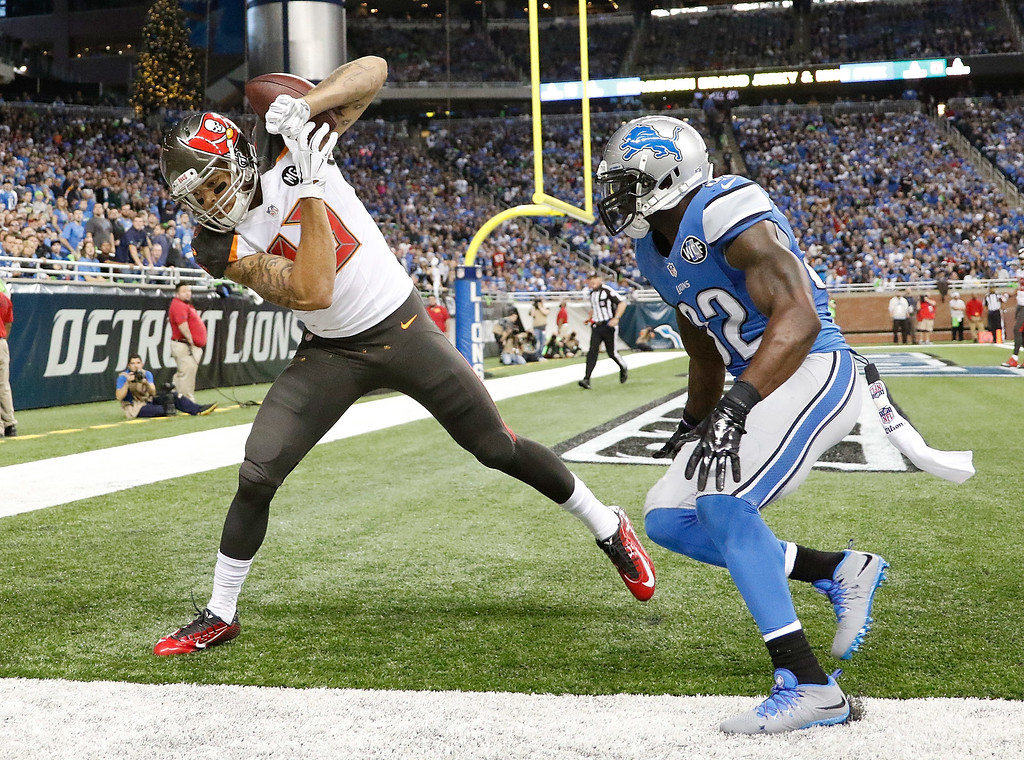 . DETROIT, MI - DECEMBER 7: Mike Evans #13 of the Tampa Bay Buccaneers catches a fourth quarter touchdown in front of James Ihedigbo #32 of the Detroit Lions at Ford Field on December 7, 2014 in Detroit, Michigan. (Photo by Leon Halip/Getty Images)