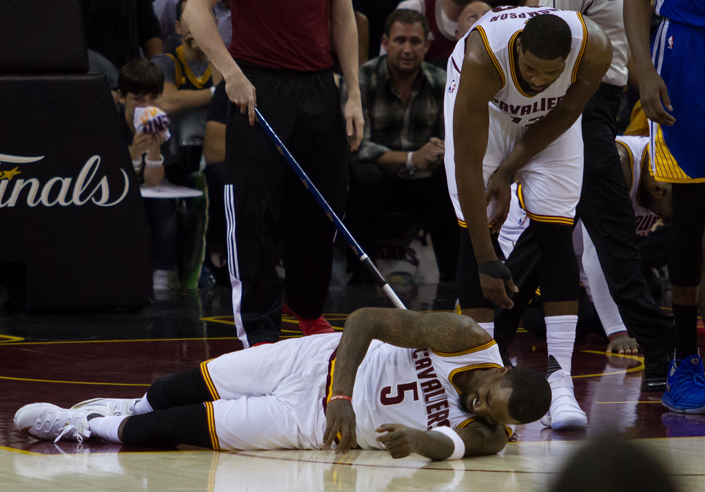 . JR Smith of the Cleveland Cavaliers goes down after a collision during game 4 of the NBA Finals against the Golden State Warriors at the Quicken Loans Arena on June 10, 2017.  The Cavs defeated the Warriors 137-116.