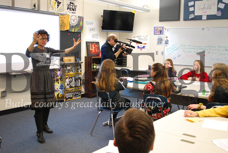 Educator Susan Stein, who wrote a one-woman play based on the diaries and letters of Holocaust victim Etty Hillesum, led a discussion about the Holocaust with students in Ezekiel Stroupe's seventh and eighth grade gifted education classes on Monday at Seneca Valley. Stein's visit came as part of Stroupe's selection by the Seneca Valley Foundation to be a Classrooms Without Borders (CWB) scholarship recipient. Five district teachers will travel to Poland or Greece for two weeks this summer to study the Holocaust and bring the experience back to the school district's classrooms.