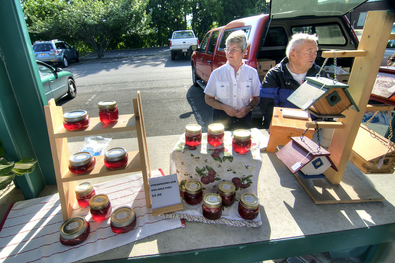 A couple sell birdhouses (made by the husband) and jam (made by the wife) at the Farmers Market on Main Street in Galax, VA on Friday, May 31, 2013. Copyright 2013 Jason Barnette