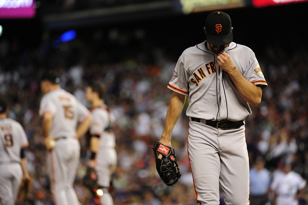 . DENVER - JUNE 28: Barry Zito #75 of the San Francisco Giants leaves the pitchers mound after giving up four runs in the first three innings during a baseball game against the Colorado Rockies on June 28, 2013 at Coors Field. (Photo By Grant Hindsley / The Denver Post)