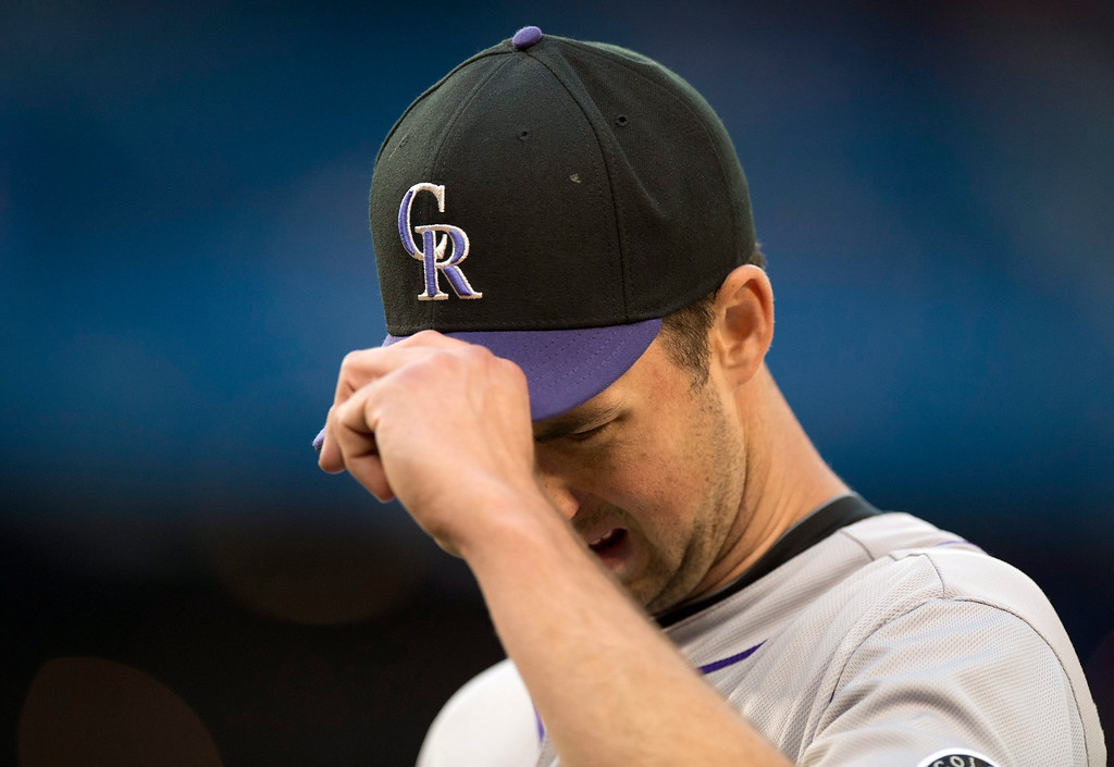 . Colorado Rockies pitcher Jeff Francis reacts as he walks off the field after the fifth inning of an inter-league baseball game in Toronto on Tuesday June 18, 2013.   (AP Photo/The Canadian Press, Frank Gunn)