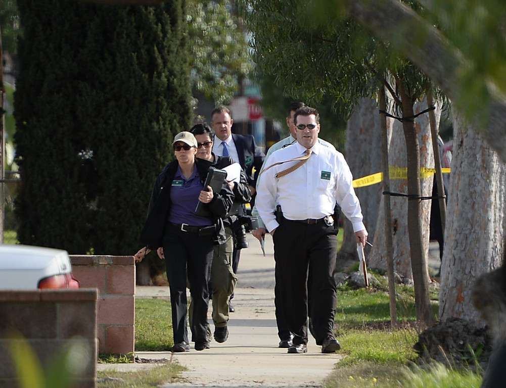 . Los Angeles Sheriffs Dept. detectives and crime lab members investigate the scene of an officer involved shooting on Ruthelen Avenue Monday, March 03, 2014, Gardena, CA.   Gardena police responded to a call of a residential burglary and shot one of the suspects. Photo by Steve McCrank/Daily Breeze