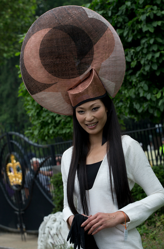 . Wei Lin from Taiwan  wears an ornate hat on the third day traditionally known as Ladies Day of the Royal Ascot horse race meeting in Ascot, England, Thursday, June 20, 2013. (AP Photo/Alastair Grant)