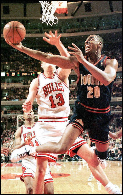 . 1992: LaPhonso Ellis (No. 5) Denver Nuggets forward LaPhonso Ellis (R) drives by Chicago Bulls center Luc Longley in the first quarter 18 February of their game at the United Center in Chicago. (Photo credit should read VINCENT LAFORET/AFP/Getty Images)