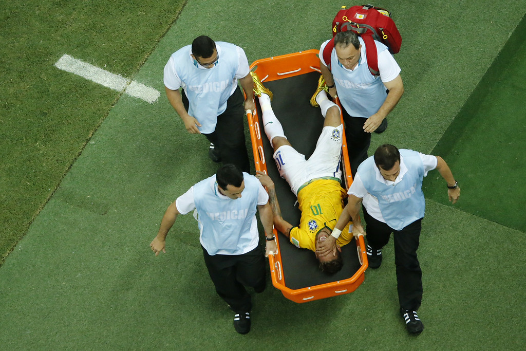 . Brazil\'s forward Neymar is carried on a stretcher after being injured during the quarter-final football match between Brazil and Colombia at the Castelao Stadium in Fortaleza during the 2014 FIFA World Cup on July 4, 2014.  FABRIZIO BENSCH/AFP/Getty Images