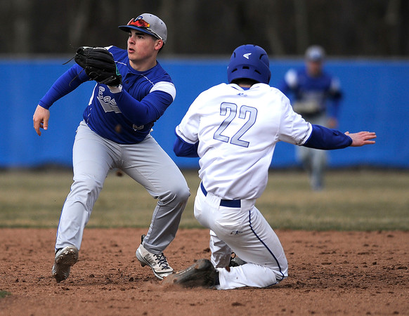 4/5/2018 Mike Orazzi   Staff Bristol Eastern High School's Matt D'Amato (2) as Plainville's Brady Callahan (22) slides safely into second base Thursday afternoon in Plainville.
