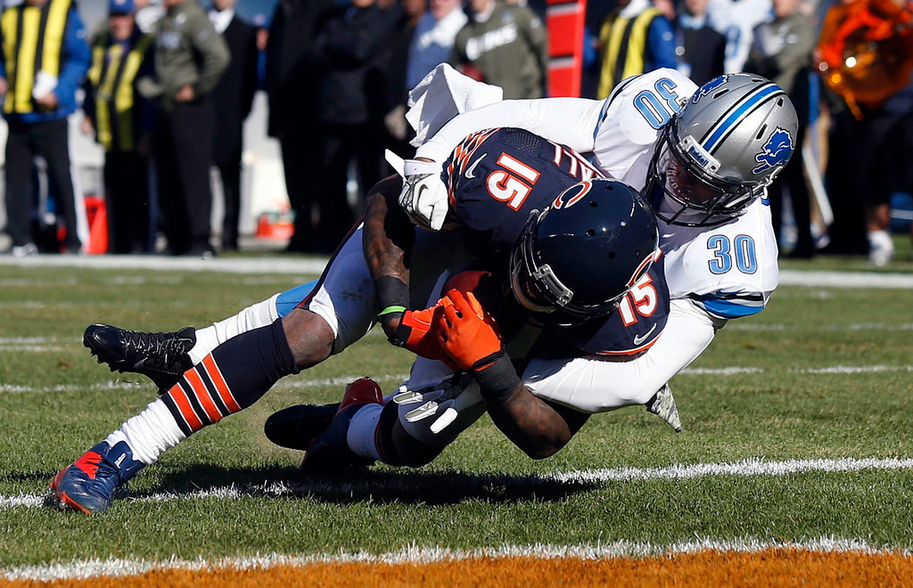 . Chicago Bears wide receiver Brandon Marshall (15) makes a touchdown reception against Detroit Lions cornerback Darius Slay (30) during the first half of an NFL football game on Sunday, Nov. 10, 2013, in Chicago. (AP Photo/Charles Rex Arbogast)