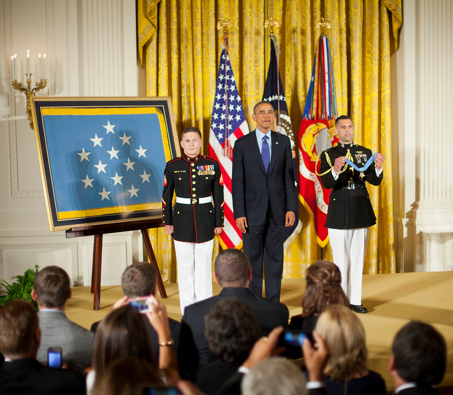 ". President Barack Obama stands with retired Marine Cpl. William ""Kyle\"" Carpenter, left, before awarding him the Medal of Honor, Thursday, June 19, 2014, in the East Room of the White House in Washington.  (AP Photo/Pablo Martinez Monsivais)"