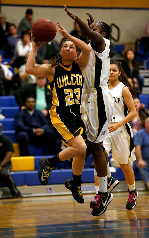 . Wilcox High School\'s Shania Ratliff (23) takes a shot against Archbishop Mitty High School\'s JiaJai Craig (55) in the first period for the CCS Open Division Girls Basketball semifinals at Oak Grove High School in San Jose, Calif., on Wednesday, Feb. 27, 2013.  (Nhat V. Meyer/Staff)