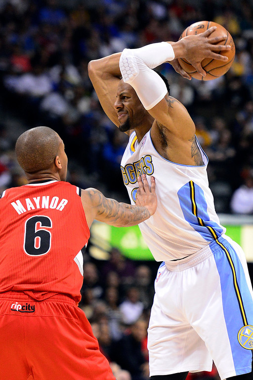 . DENVER, CO - APRIL 14: Eric Maynor (6) of the Portland Trail Blazers defends Andre Iguodala (9) of the Denver Nuggets during the first half of action. The Denver Nuggets play the Portland Trail Blazers at the Pepsi Center. (Photo by AAron Ontiveroz/The Denver Post)