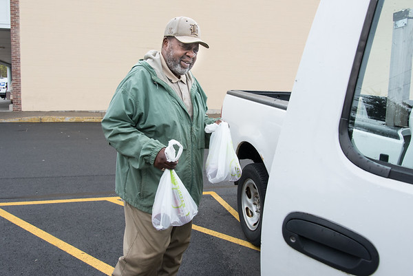 04/22/19 Wesley Bunnell | Staff Walter L. Jones of New Britain loads his groceries into his truck on the side of the Stop & Shop on Corbin Ave in New Britain on Monday afternoon on the first day back to work for striking employees.