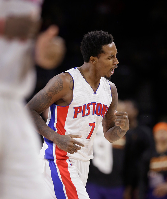 . Detroit Pistons guard Brandon Jennings reacts after a three point basket during the second half of an NBA basketball game against the Phoenix Suns in Auburn Hills, Mich., Wednesday, Nov. 19, 2014. (AP Photo/Carlos Osorio)