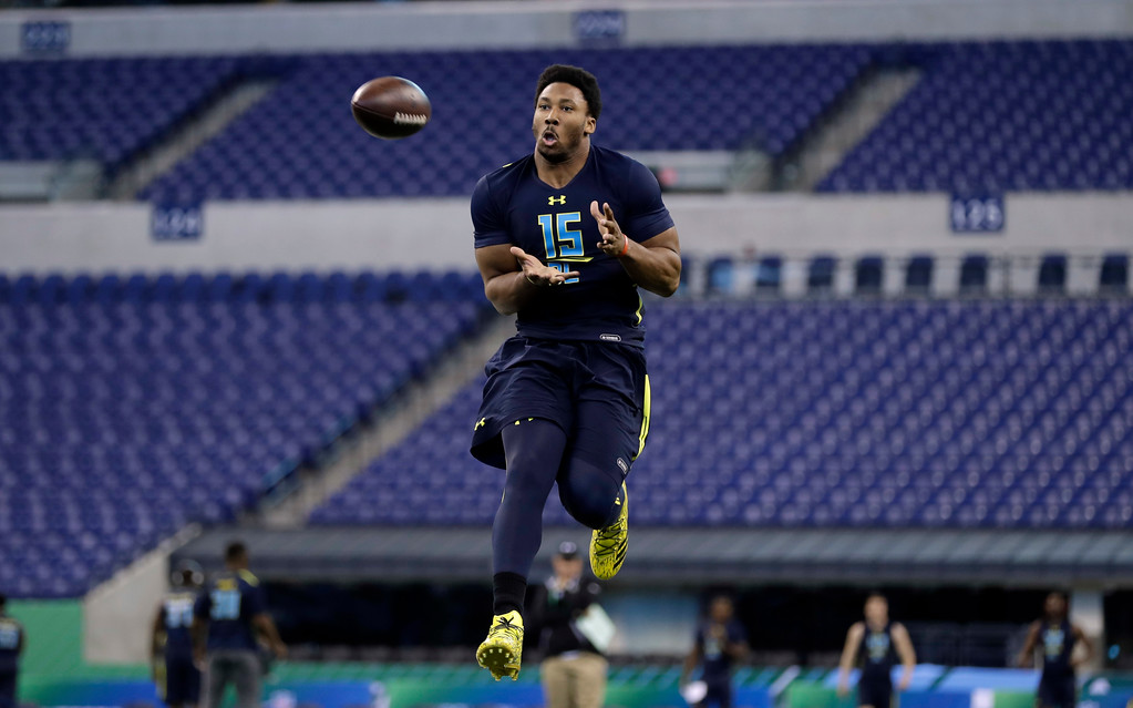 . Texas A&M defensive end Myles Garrett catches a pass during a drill at the NFL football scouting combine, Sunday, March 5, 2017, in Indianapolis. (AP Photo/David J. Phillip)