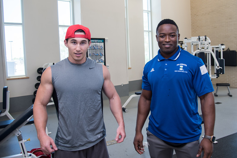 Students' Nicco Cassinelli (Left) and Christian Habihirwe hang out in the Dugan Wellness Center.