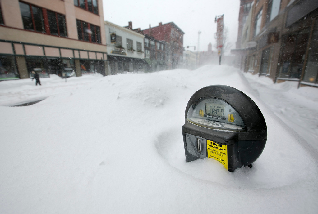 . A parking meter pokes out of a snow bank during a blizzard, Saturday, Feb. 9, 2013, in Portland, Maine. The storm dumped more than 30 inches of snow as of Saturday afternoon, breaking the record for the biggest storm on record. (AP Photo/Robert F. Bukaty)