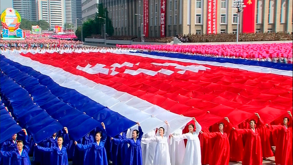 . In this image taken from video North Koreans form a North Korean flag while performing during a military parade marking the 65th anniversary of the country\'s founding, Monday, Sept. 9, 2013, in Pyongyang, North Korea. (AP Photo/KRT via AP Video)