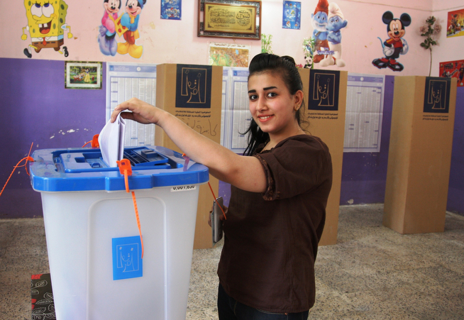 Description of . An Iraqi woman casts her vote at a polling centre in upscale Mansour Sunni district of Baghdad on April 30, 2014 in the country's first parliamentary election since US troops withdrew. Iraqis streamed to voting centres nationwide, amid the worst bloodshed in years, as Prime Minister Nuri al-Maliki seeks re-election. (KHALIL AL-MURSHIDI/AFP/Getty Images)