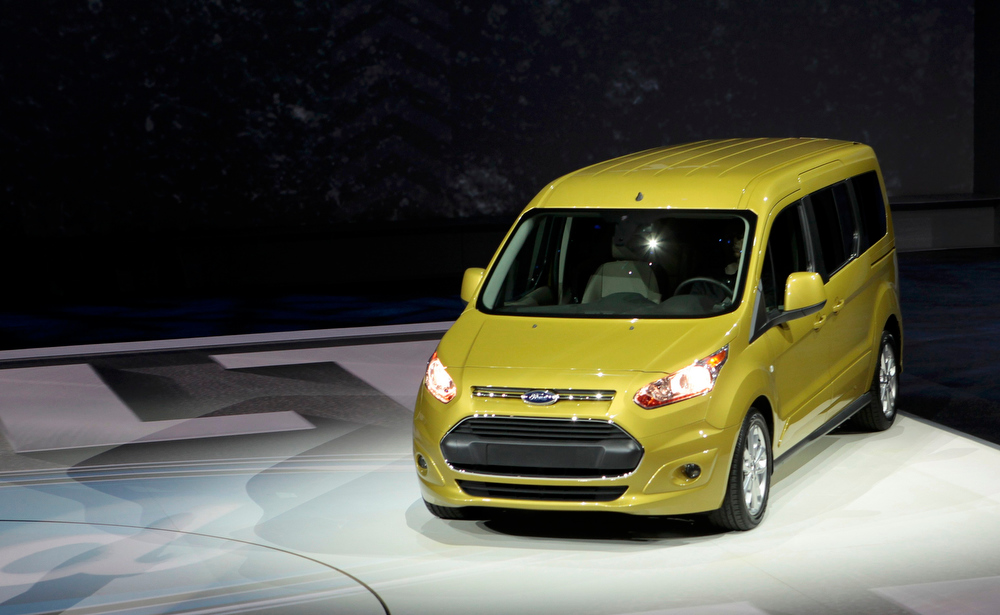 . The 2014 Ford Transit Connect comes on stage to be displayed at the North American International Auto Show in Detroit, Michigan January 15, 2013. REUTERS/Rebecca Cook