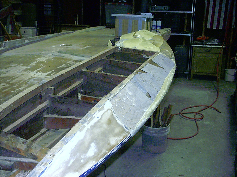 Removing kevlar repair and non trip from starboard sponson.