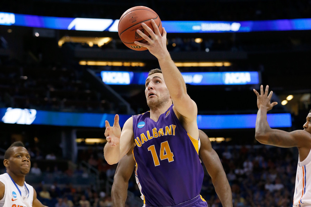 . ORLANDO, FL - MARCH 20:  Sam Rowley #14 of the Albany Great Danes goes up for a shot against Patric Young #4 of the Florida Gators in the second half during the second round of the 2014 NCAA Men\'s Basketball Tournament at Amway Center on March 20, 2014 in Orlando, Florida.  (Photo by Kevin C. Cox/Getty Images)