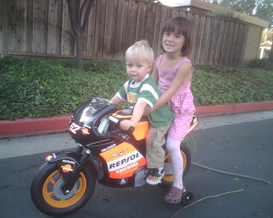 Emrick on his new Motorcyle with friend Maya