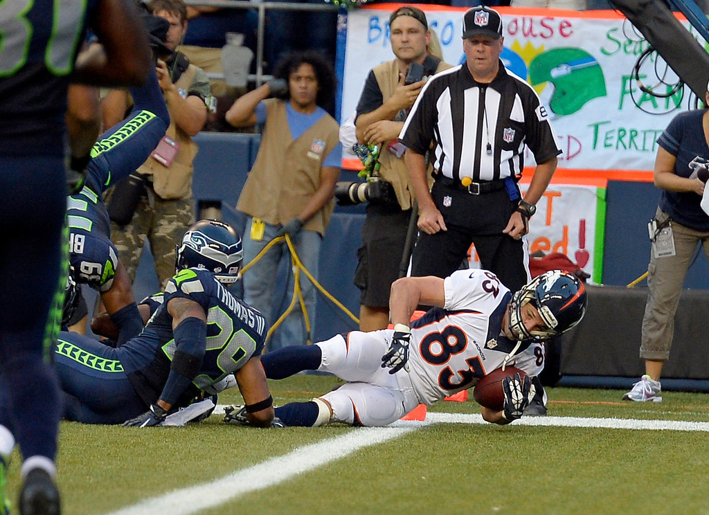 . SEATTLE, WA. - AUGUST 17: Denver Broncos wide receiver Wes Welker (83) dives over the goal line for a touchdown in the first quarter against the Seattle Seahawks August 17, 2013 at Century Link Field. (Photo By John Leyba/The Denver Post)