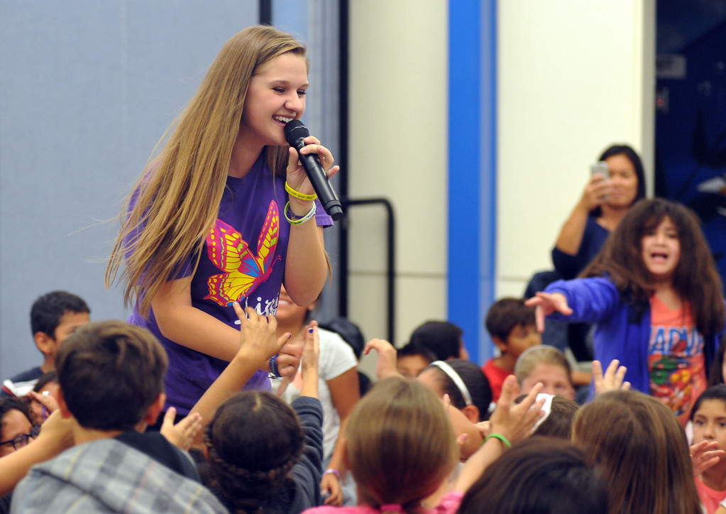 """. Country Western singer Lizzie Sider, 15, sings her song \""""Butterfly\"""" during her 80-school California Bully Prevention Tour for students at Ocean View Elementary School in Whittier on Monday November 4, 2013. (Whittier Daily News/Staff Photo by Keith Durflinger)"""