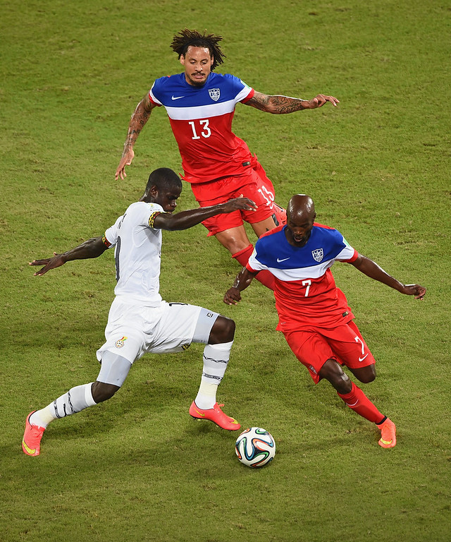 . Jonathan Mensah of Ghana and DaMarcus Beasley of the United States battle for the ball as Jermaine Jones of the United States looks on during the 2014 FIFA World Cup Brazil Group G match between Ghana and the United States at Estadio das Dunas on June 16, 2014 in Natal, Brazil.  (Photo by Laurence Griffiths/Getty Images)