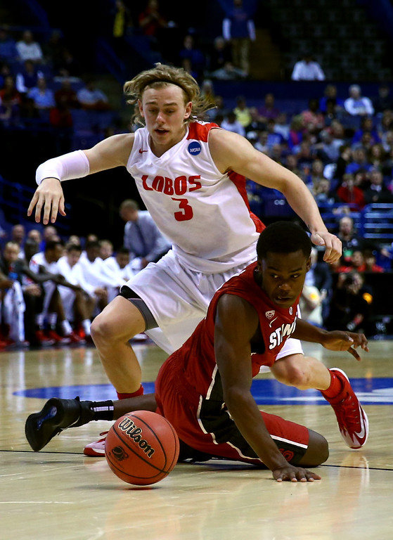 . Marcus Allen #15 of the Stanford Cardinal dives for the ball against Hugh Greenwood #3 of the New Mexico Lobos during the second round of the 2014 NCAA Men\'s Basketball Tournament at Scottrade Center on March 21, 2014 in St Louis, Missouri.  (Photo by Dilip Vishwanat/Getty Images)