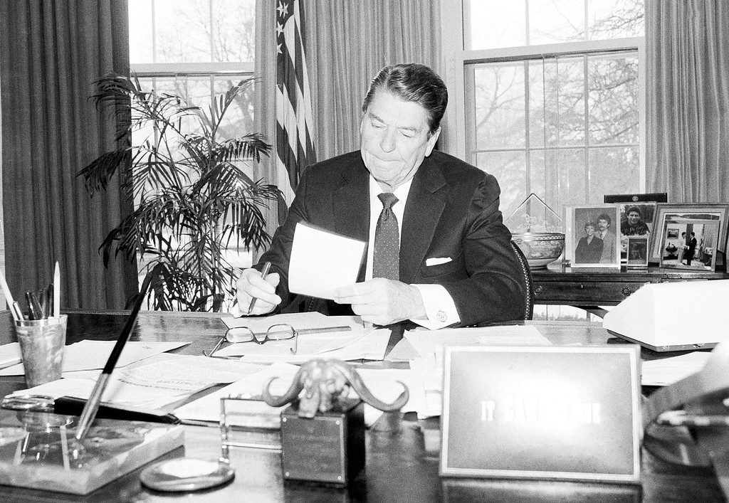 . President Ronald Reagan puts the final touches on his State of the Union speech in the Oval Office of the White House, Jan. 24, 1984 in Washington. The president will deliver the address to a joint session of Congress in 9 pm on Thursday. (AP Photo/Barry Thumma)