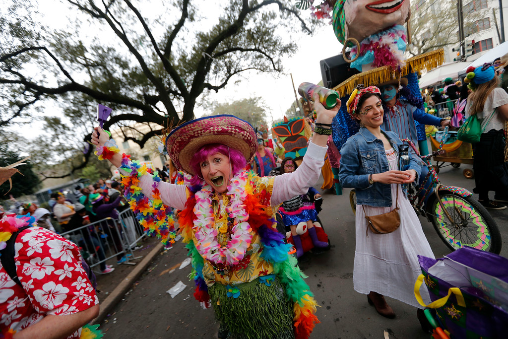 . A member of the walking club Mondo Kayo revels as they march and dance down the route of the Krewe of Zulu parade on Mardi Gras day in New Orleans, Tuesday, Feb. 13, 2018. (AP Photo/Gerald Herbert)