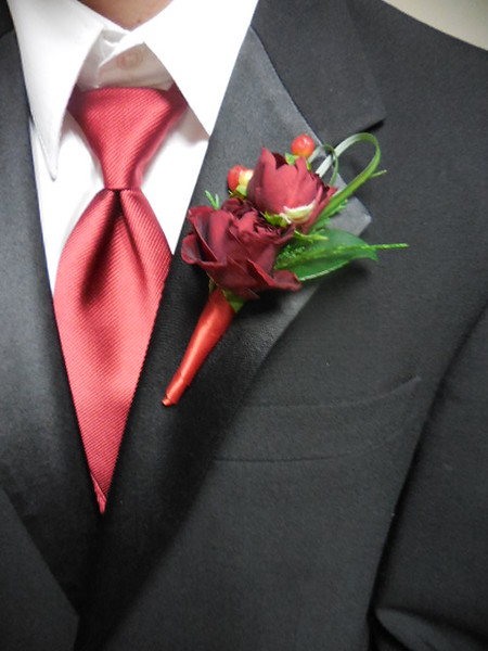Double small red rose Bout $28