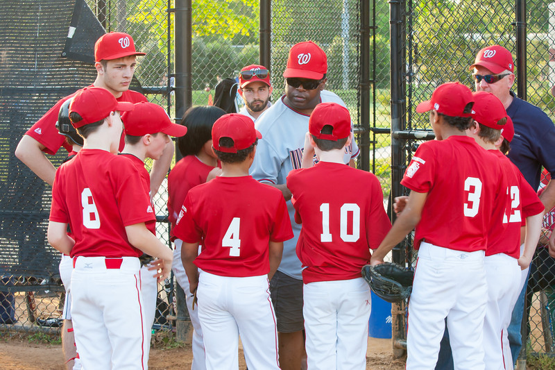 Coach Coop getting the team fired up as they go into the bottom of the 6th inning trailing by one. The Nationals played an excellent defensive game, but came up just a little short against the Pirates who scored the go-ahead run in the top of the 6th inning, winning 2-1. They are now 4-3 for the season. 2012 Arlington Little League Baseball, Majors Division. Nationals vs Pirates (01 May 2012) (Image taken by Patrick R. Kane on 01 May 2012 with Canon EOS-1D Mark III at ISO 800, f8.0, 1/100 sec and 70mm)