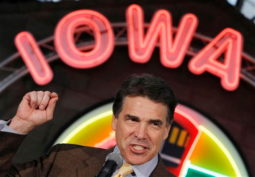 . FILE - In this Aug. 16, 2011 file photo, Republican presidential candidate, Texas Gov. Rick Perry, makes a campaign stop at the Iowa 80 Group in Walcott, Iowa. Perry announced Monday, July 8, 2013, that he would not seek re-election as Texas governor next year. (AP Photo/Charles Dharapak, File)