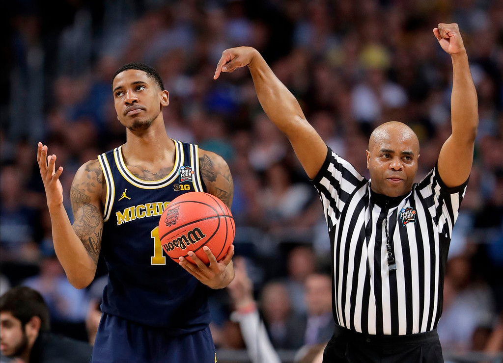 . Michigan\'s Charles Matthews (1) reacts to a foul call during the second half in the championship game of the Final Four NCAA college basketball tournament against Villanova, Monday, April 2, 2018, in San Antonio. (AP Photo/Eric Gay)